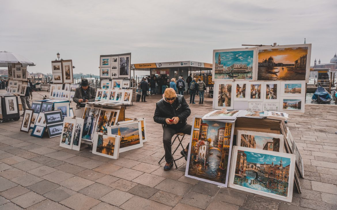 People selling art and paintings in Venice.