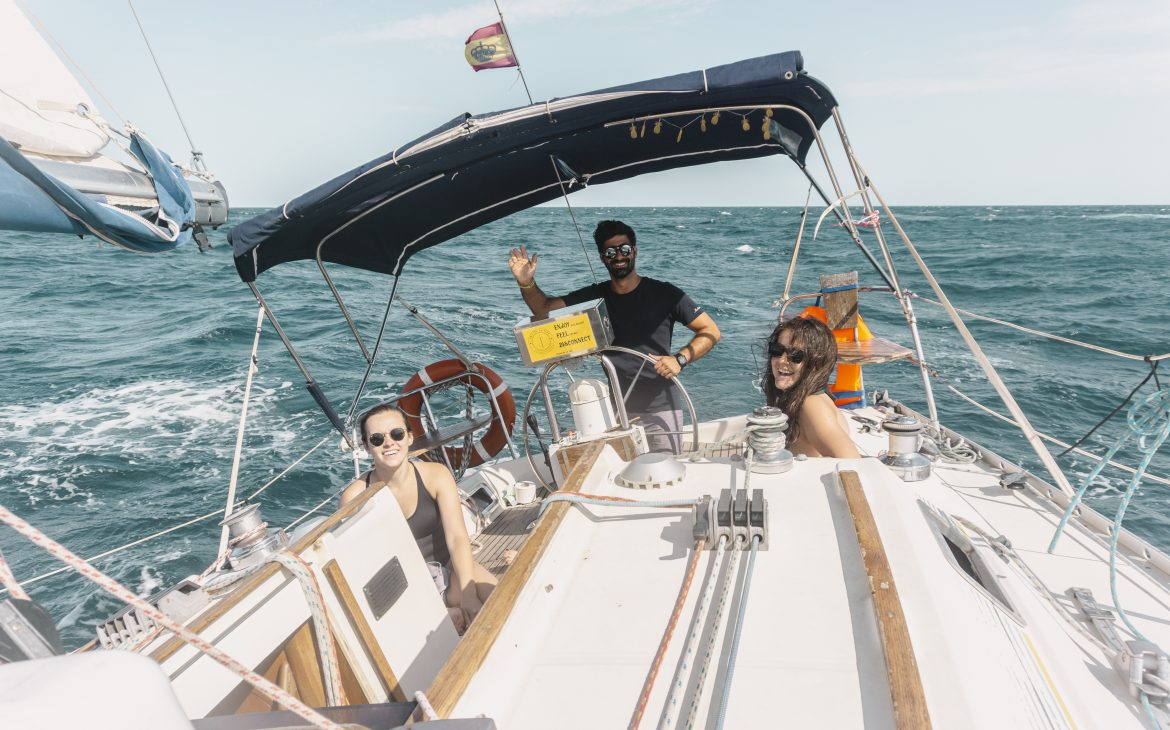 Airbnb sailing experience in Barcelona, smiling people on the boat.