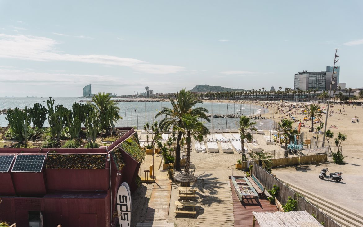 Barcelona city beach and the harbor view.